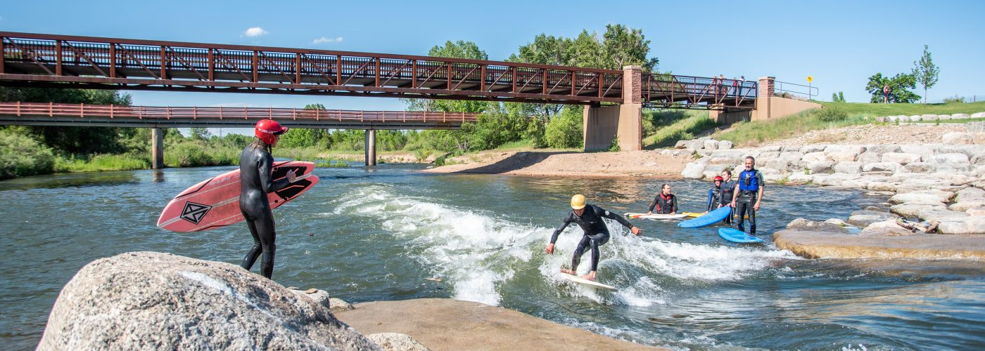 Adults Surfing at River Run